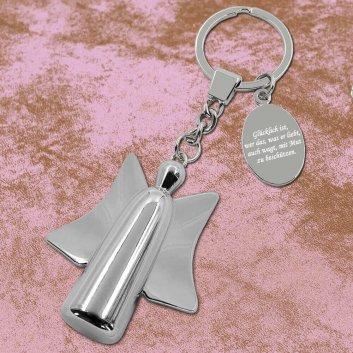 Beschützer Schlüsselanhänger mit Gravur auf Lederunterlage